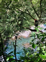 People hiking down the river at the Cascade de Grand Gallet, Riviere de Langevin, Reunion Island Things to do in Reunion Island #waterfall #reunion #nature #traveltips #travels
