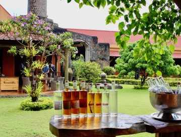 Rum bottles and a view of Chamarel, during the visit of the Rum distillery. Located in the Southern part of Mauritius. Things to do in Mauritius