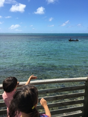 Kiddos looking at Fishermen boat and View of Lagoon on East Coast of Mauritius - Devil's Point Mauritius - The battle of Grand Port in Mauritius - #Mauritius #Ilemaurice #Things to do in Mauritius #cultural visits in Mauritius