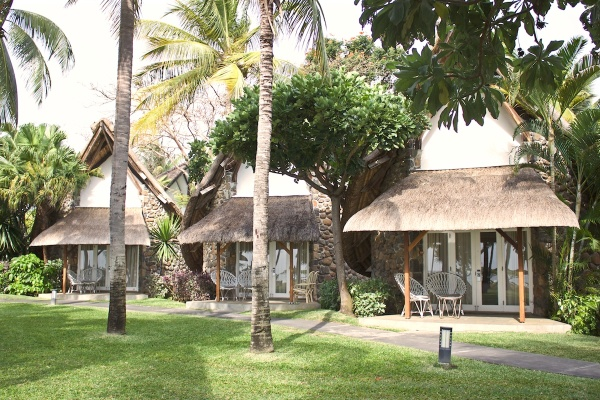View of the Thatch-roofed bungalows at la Pirogue Hotel, Mauritius