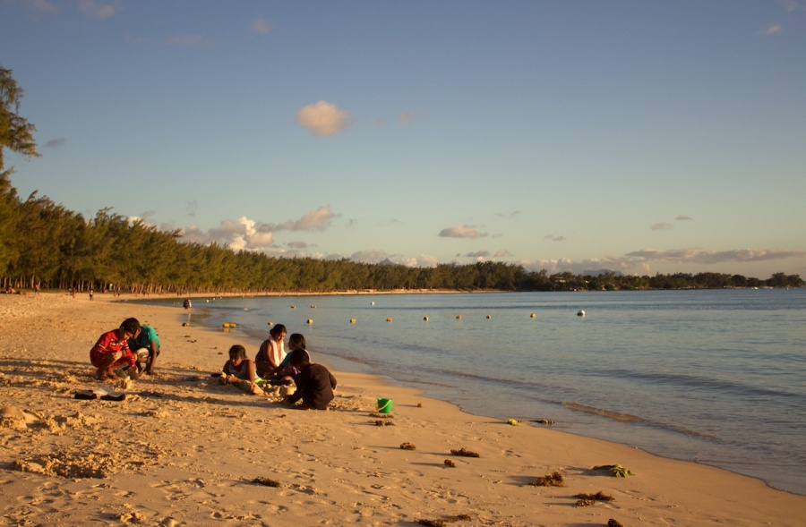 children playing on the beach in Mont Choisy. One of the best beaches in Mauritius