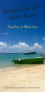 Taxi boat on Trou-aux-Biches beach in Mauritius with clear blue sky and beautiful lagoon