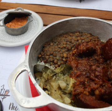 Traditional dish from Reunion island: Rougaille saucisses, veg and lentils served with rice and chilli paste