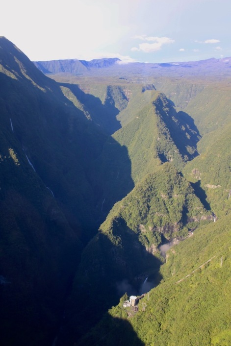 View of Reunion Island from helicopter: waterfalls and hydraulic station