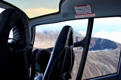 view from inside the helicopter with the Piton de la Fournaise in the background