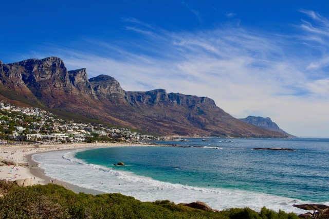 Coastline in Cape Town with Twelve Apostles in background - #capetown #coast #campsbay #clifton #southafrica