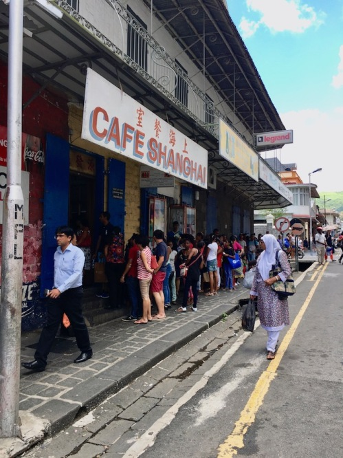 People queuing for street food at a local restaurant in Port Louis #mauritius